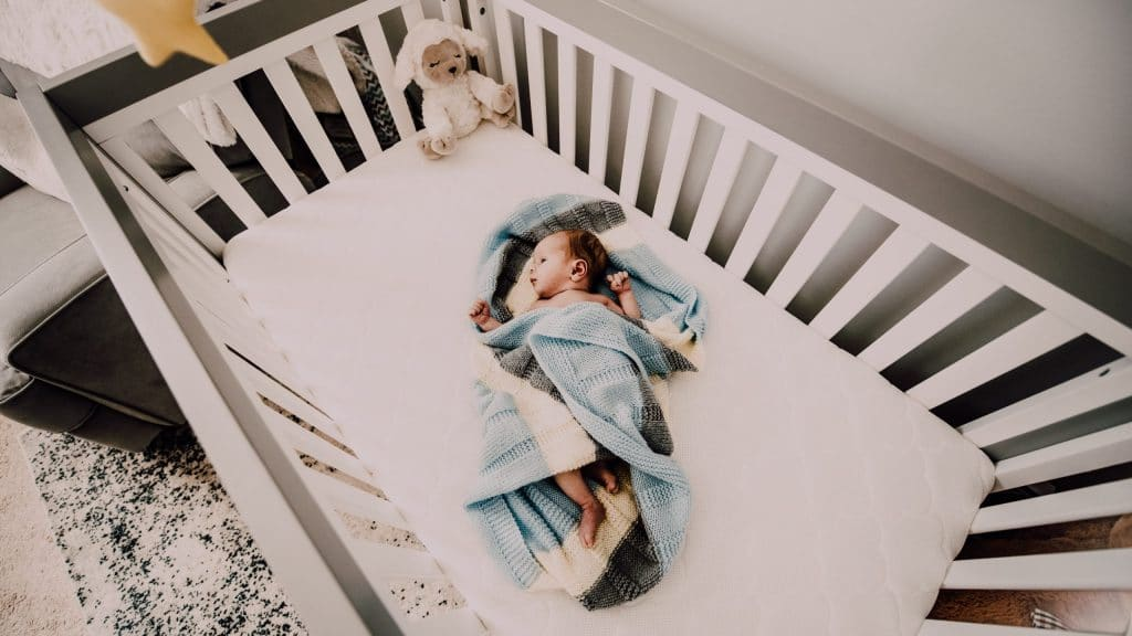Best Convertible Baby Cribs- picture of baby in a convertible crib